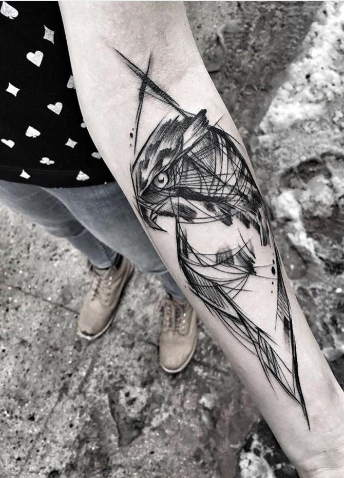 Large blackwork style forearm tattoo of eagle painted by Inez Janiak