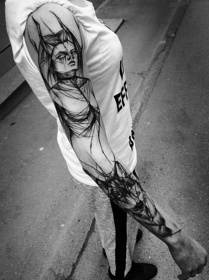 Large blackwork style painted by Inez Janiak sleeve tattoo of demonic woman with wolf