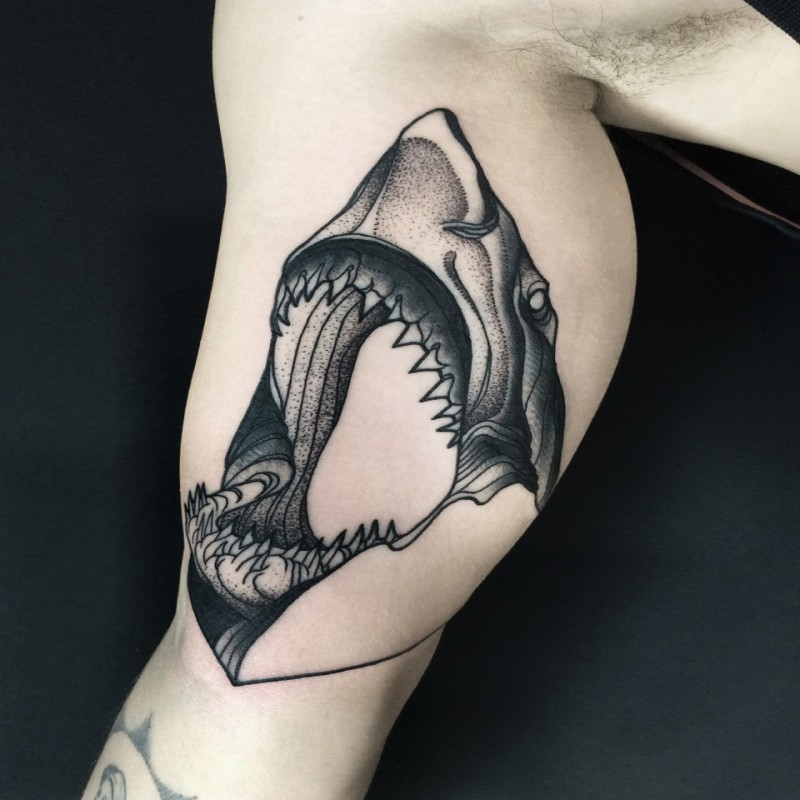 Large blackwork style painted by Michele Zingales biceps tattoo of shark head
