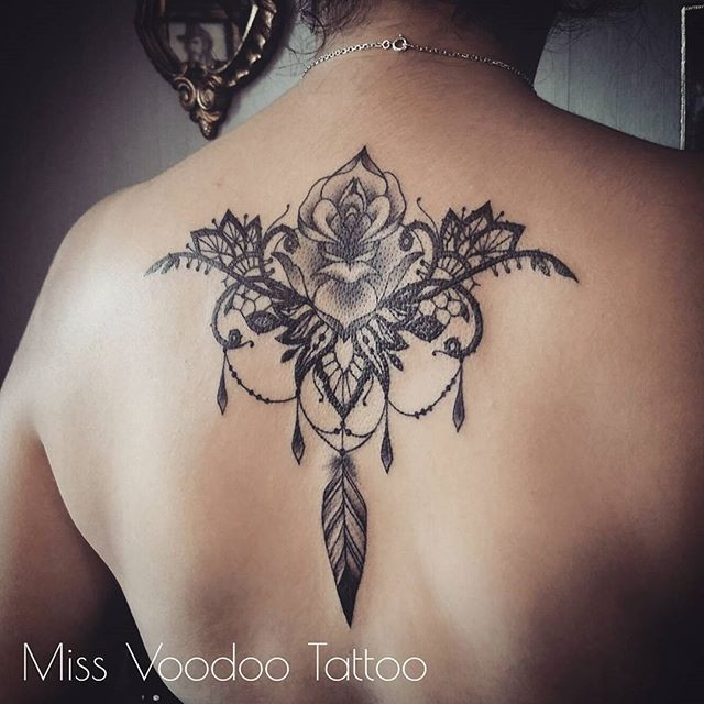 Large blackwork style upper back tattoo of large flower by Caro Voodoo