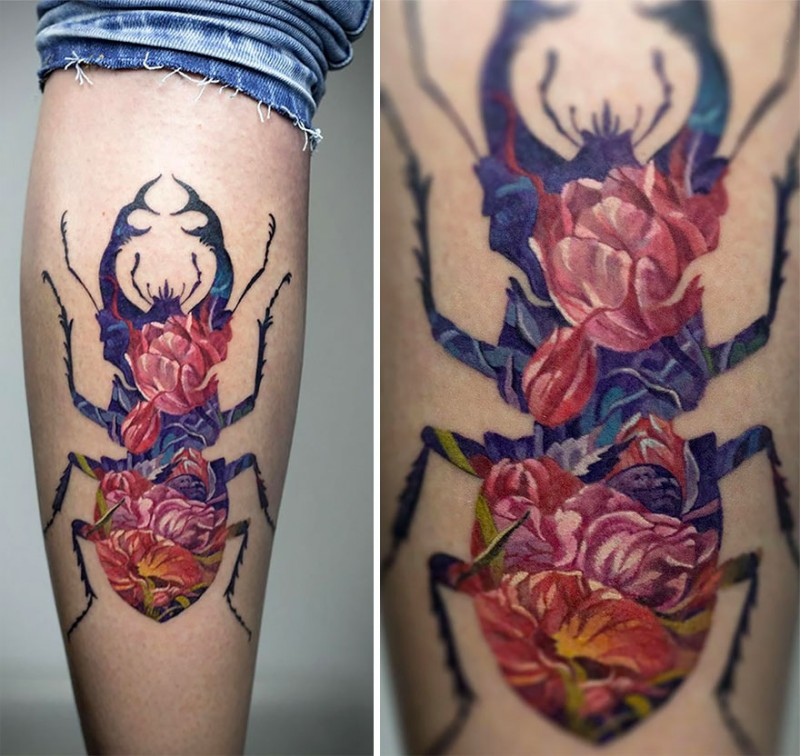 Large illustrative style colored leg tattoo of big bug stylized with flowers