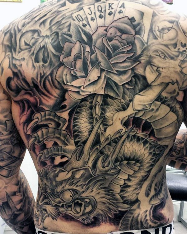 Large japanese style colored whole back tattoo of dragon with rose and playing cards