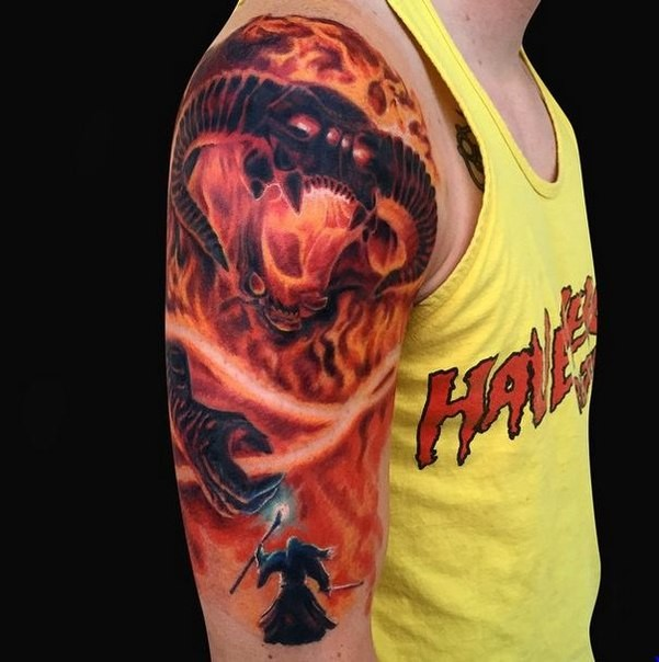 Large very beautiful colored shoulder tattoo of Lord of the Rings demon with wizard