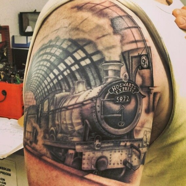 Life like  detailed upper arm tattoo of vintage train and lettering