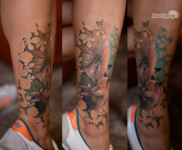 Lifelike sweet looking colored leg tattoo of fox family
