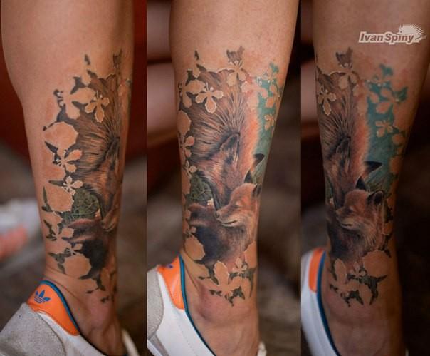 Lifelike sweet looking colored leg tattoo of fox family