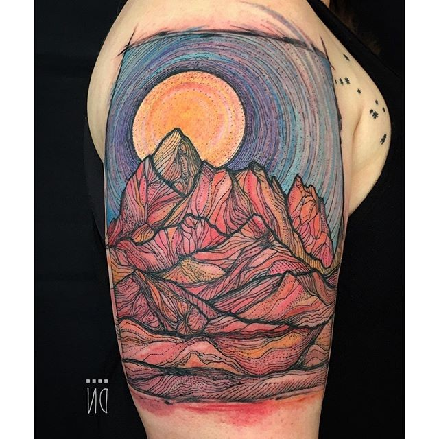 Linework style big colored upper arm tattoo of high mountains