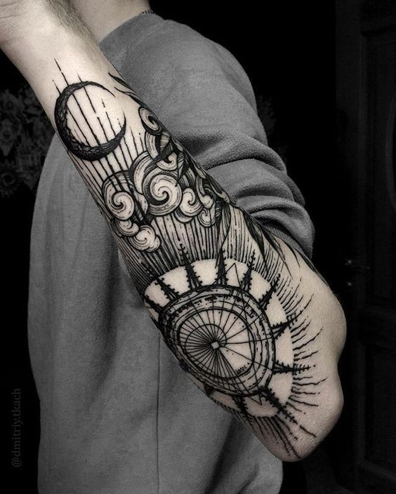 Linework style cool painted forearm tattoo of big sun and moon with cloud