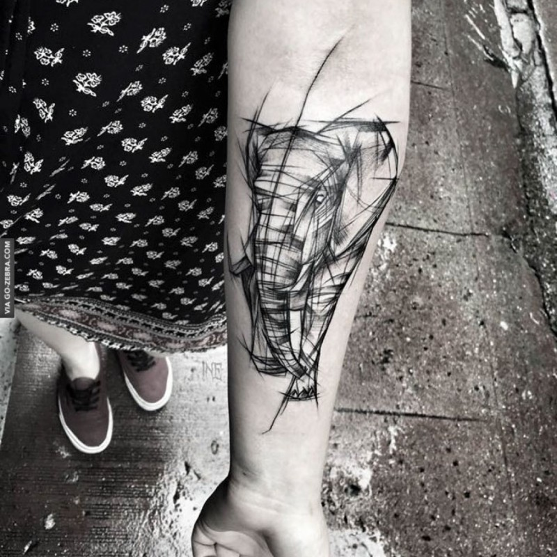 Linework style designed by Inez Janiak forearm tattoo of walking elephant