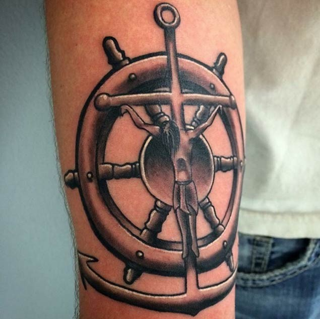 Little colored nautical themed forearm tattoo of anchor with steering wheel
