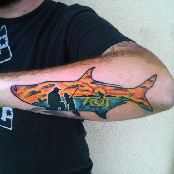Little fish shaped tattoo stylized with fishing family tattoo on leg