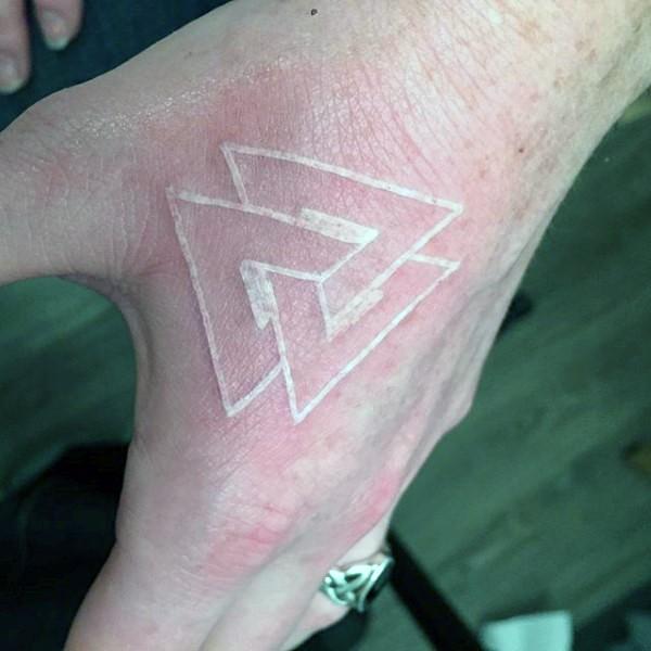 Little geometrical white ink tattoo on hand