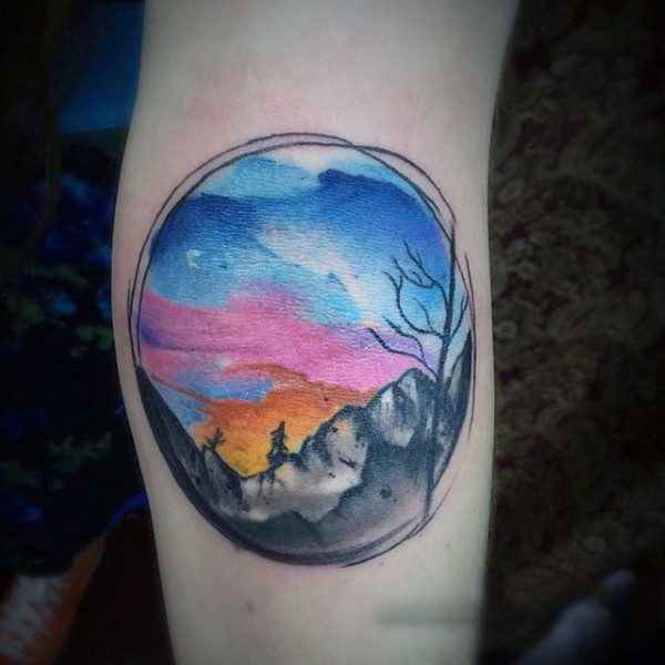 Little multicolored sunset with mountains tattoo on elbow
