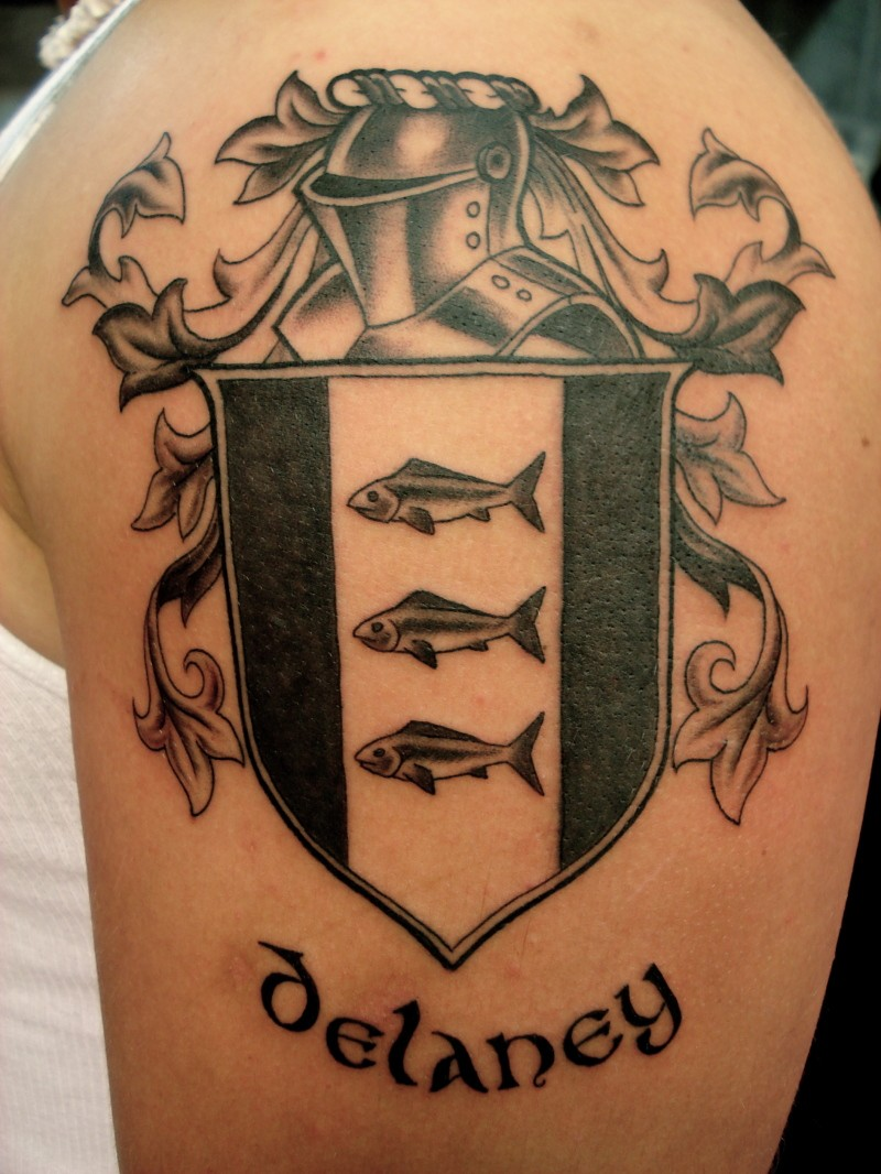 Lovely black gray family crest tattoo on shoulder