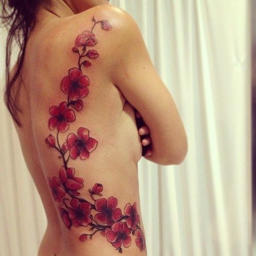 Lovely branch of cherry blossoms tattoo on ribs