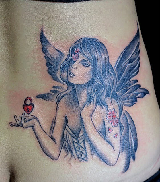 Lovely fairy with red heart tattoo on ribs