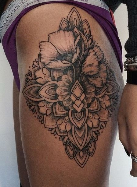 Lovely floral patterns tattoo on hip