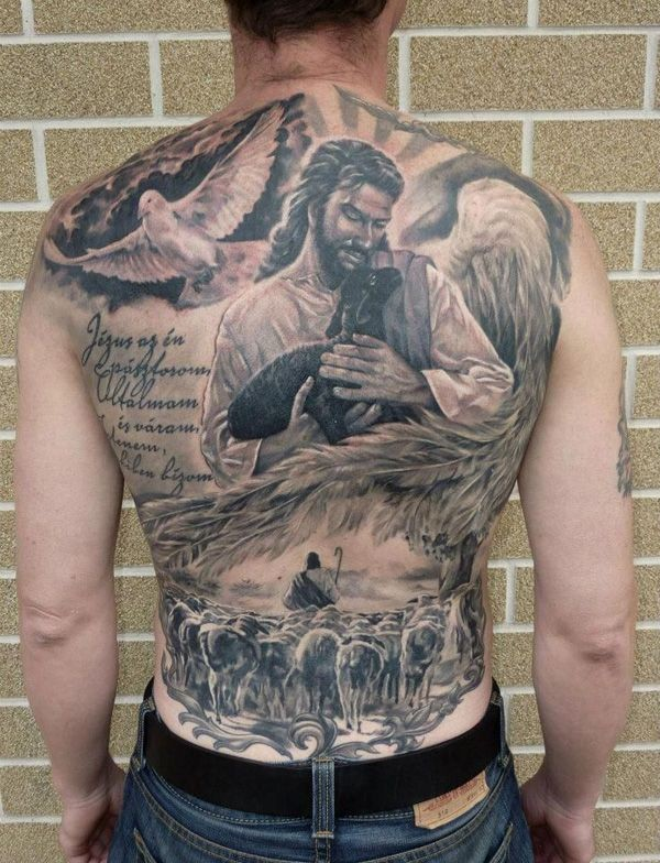 Lovely jesus with a lamb and dove tattoo on whole back