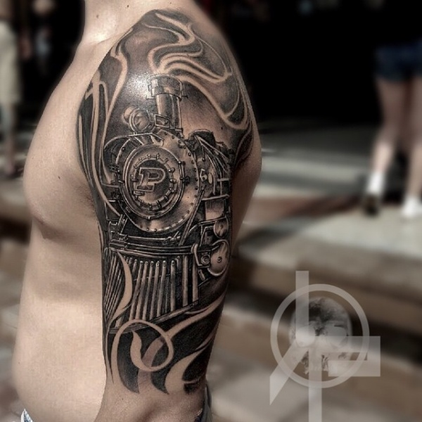 Magnificent black and white train tattoo on upper arm