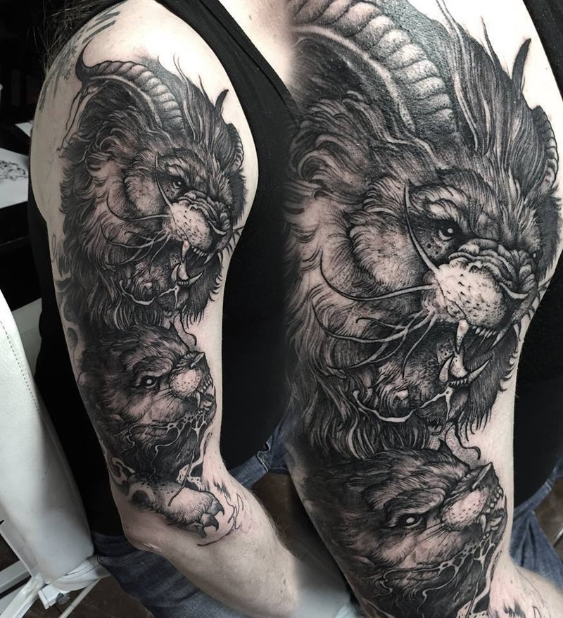 Magnificent black ink half sleeve tattoo of demonic lion with goat horns