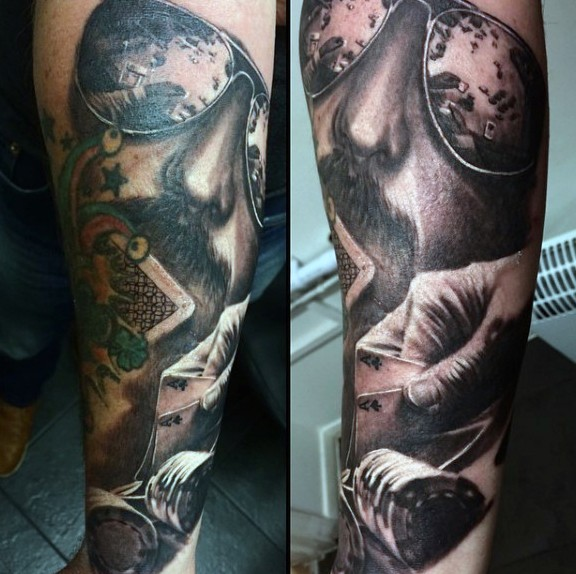 Magnificent gambling themed half colored detailed tattoo on arm