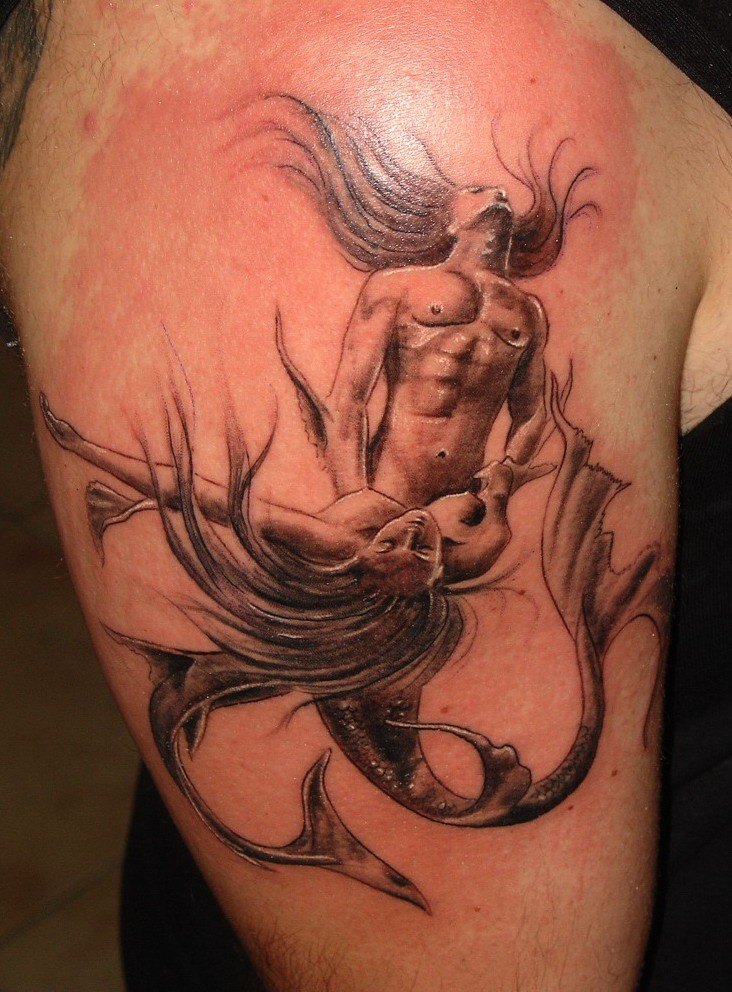 Male and female mermaids making love original idea of shoulder tattoo