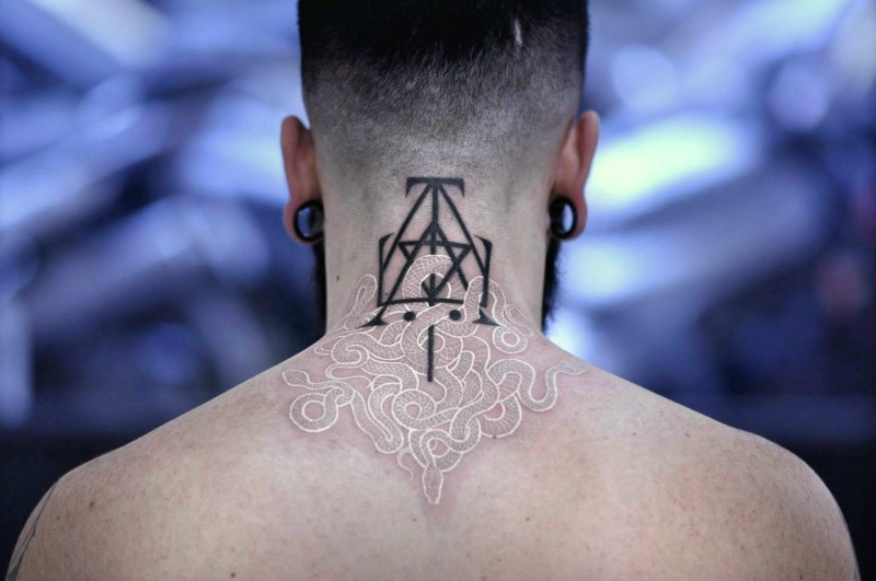 Marvelous white ink style upper back tattoo of snake combined with dark symbol