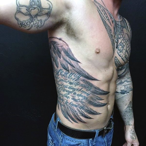Massive black and white big wing with lettering tattoo on side