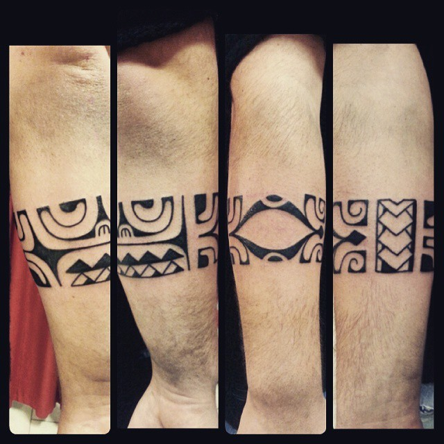 Mayan style black ink arm tattoo of ancient ornaments