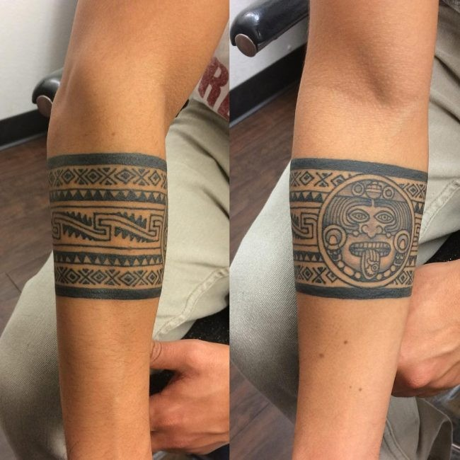 Mayan style black ink forearm tattoo of old ornament