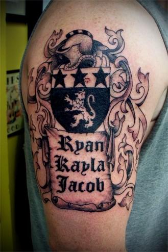 Medieval family crest tattoo on shoulder