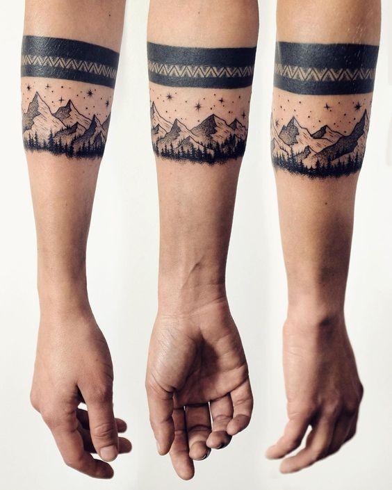Medium size black ink forearm tattoo of night mountains