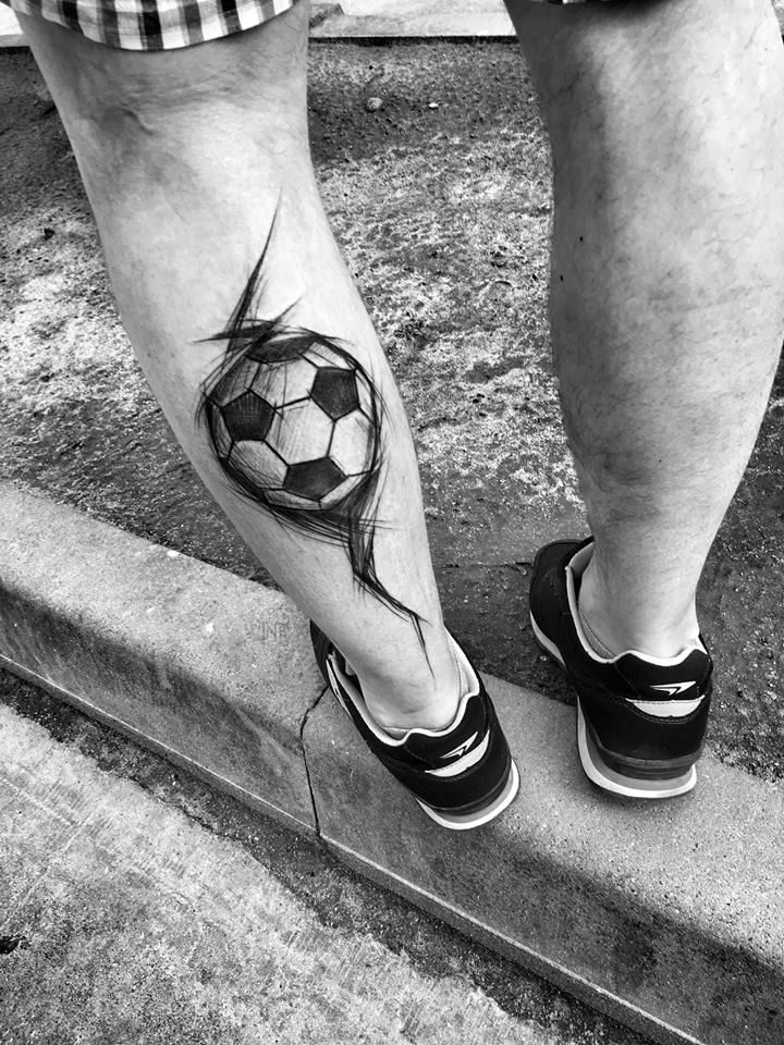 Medium size black ink painted by Inez Janiak tattoo of small black ball