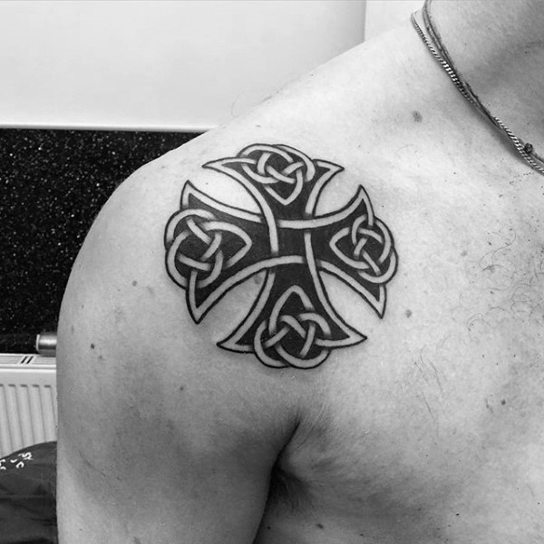 Medium size black ink shoulder tattoo fo Celtic cross
