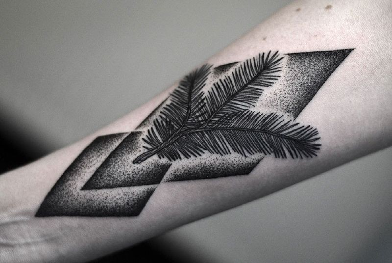 Medium size black ink stippling style forearm tattoo of tree branch and geometric figures