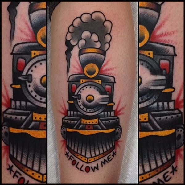 Memorial colored leg tattoo of steamy train with lettering