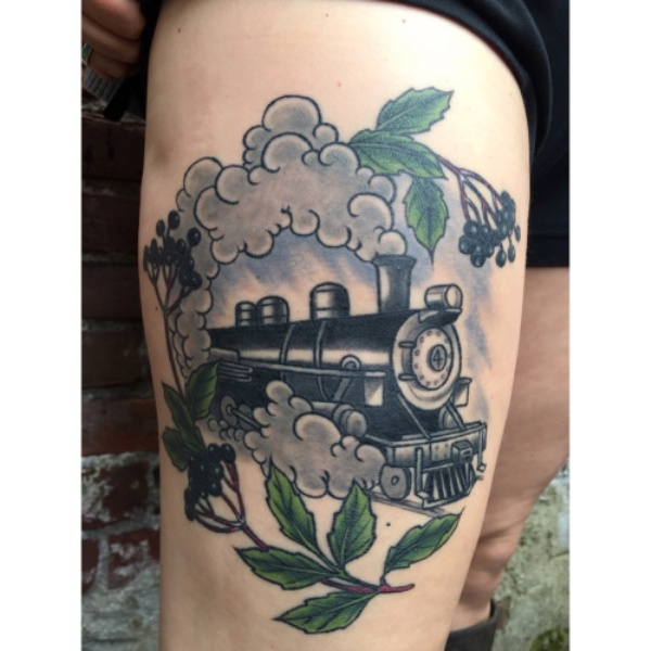 Memorial colored watercolor style thigh tattoo of train with tree branches