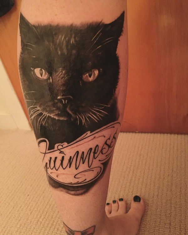 Memorial for girls cat with lettering tattoo on leg