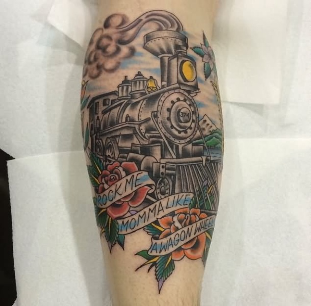 Memorial style colored leg tattoo of steam train combined with roses and lettering