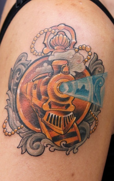 Memorial style colored shoulder tattoo of golden train with clock