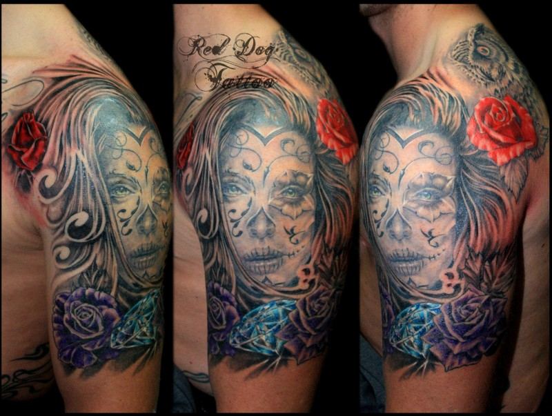 Mexican traditional beautiful looking woman with flower and diamond  tattoo on shoulder