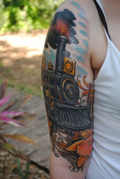 Modern art style colored upper arm tattoo of steam train with flowers