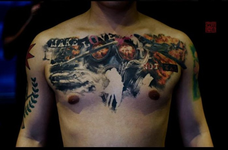 Modern military style colored chest tattoo with gas mask, planes and lettering