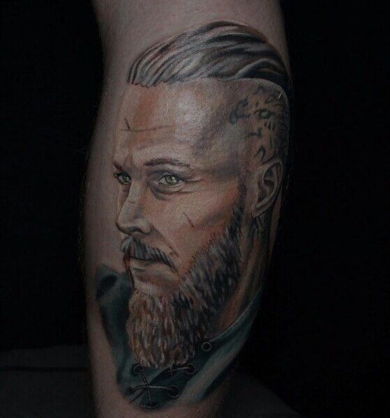 Modern style colored arm tattoo of Viking portrait