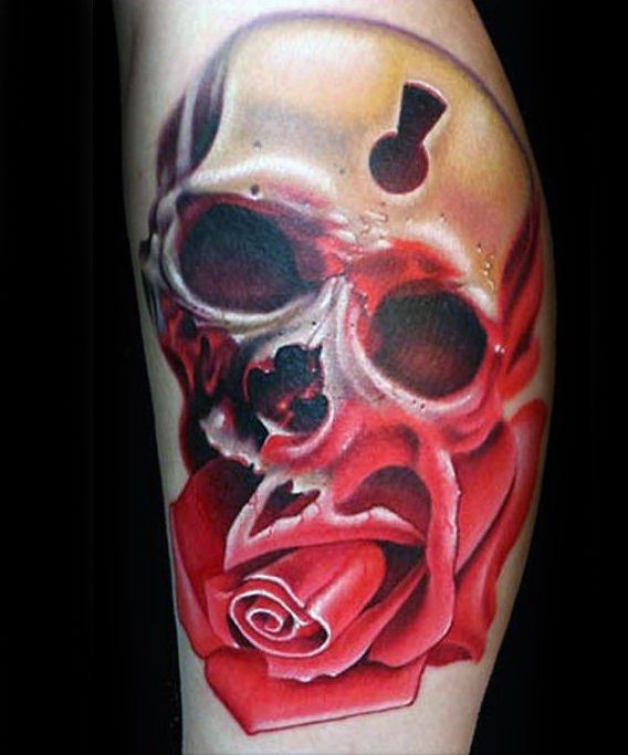 Modern style colored leg tattoo of big rose with human skull stylized with keyhole