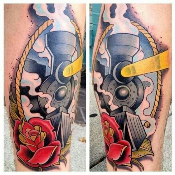 Modern style colored leg tattoo of train with flower