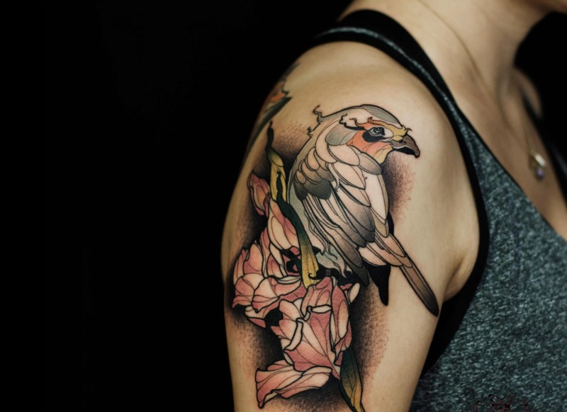 Modern style colored shoulder tattoo of big eagle with flower
