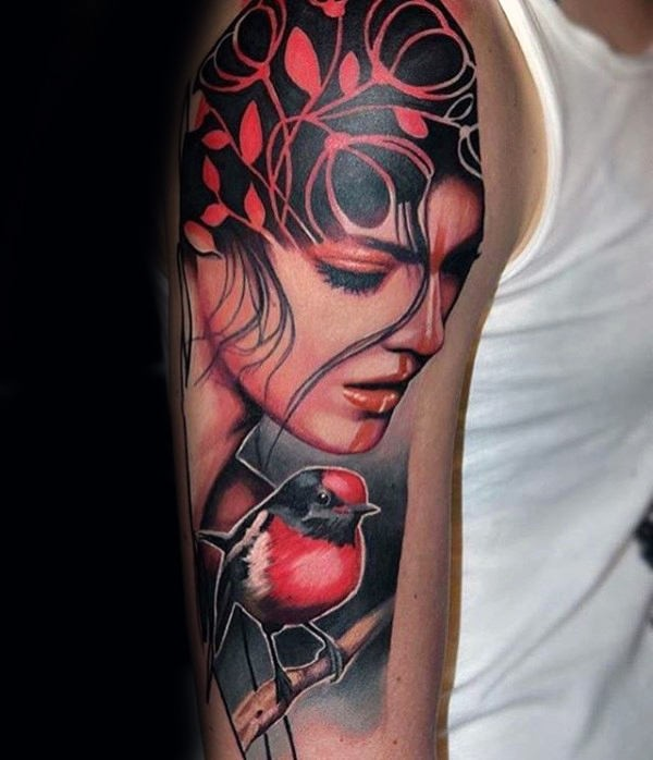 Modern style colored upper arm tattoo of woman portrait combined with small red bird