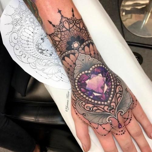 Modern style colored wrist tattoo of heart shaped diamond by Jenna Kerr