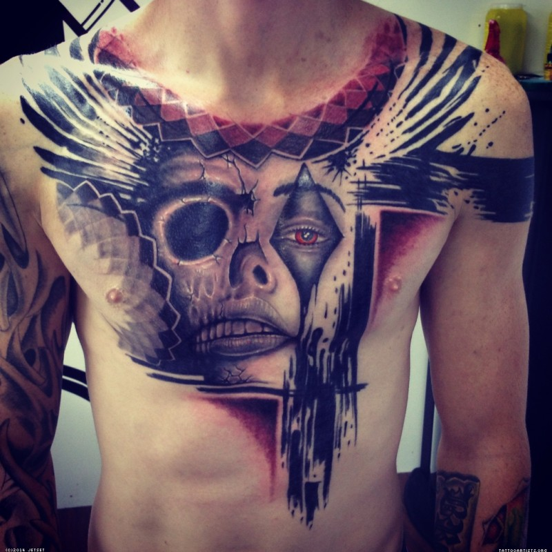 Modern traditional style colored chest tattoo of clown face with skull and wing